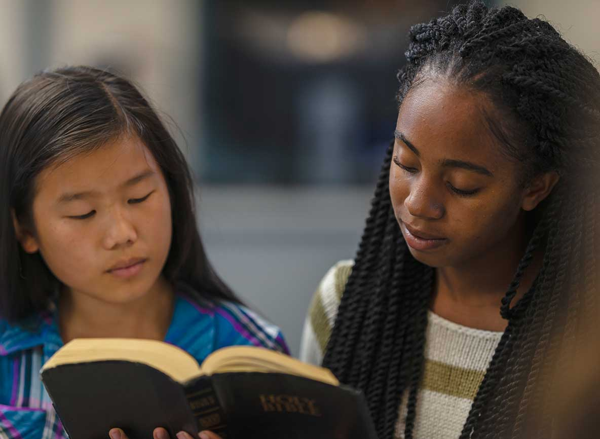 Two Children Reading Bible